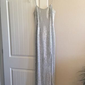 Size 5 Silver slitted gown w studded straps.